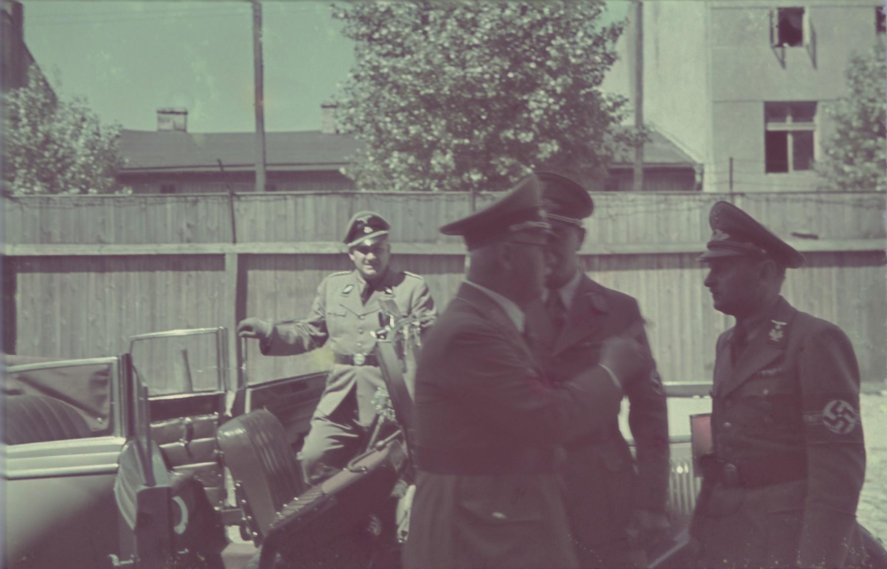 Reichchatzmeister Franz Xaver Schwarz visits the Lodz ghetto.  Also pictured are Gauleiter Arthur Greiser with his deputy Kurt Schmalz.