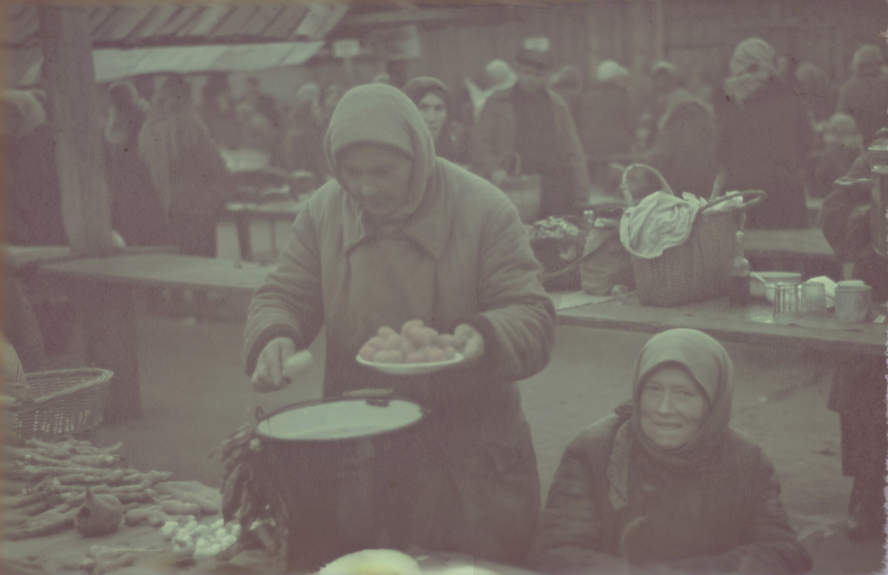 Women sell food in a market in the Lodz ghetto.