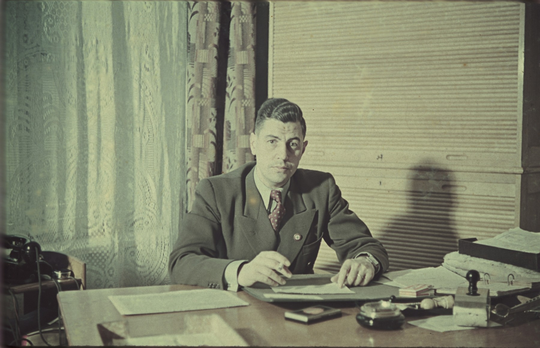 An unidentified administrator sits in his office possibly [in the Lodz ghetto].