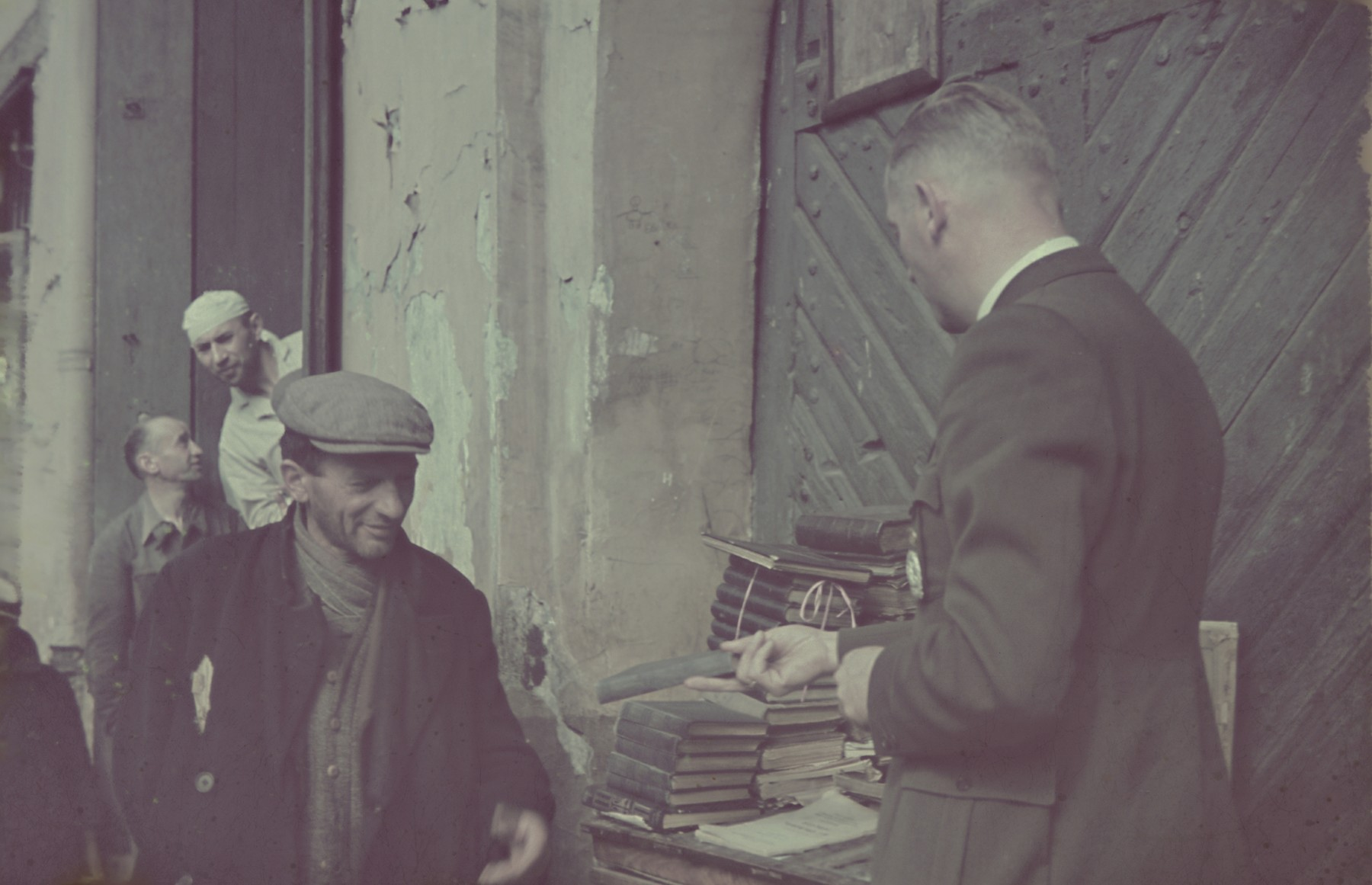 Hans Biebow purchases books from a street vendor in the Lodz ghetto.