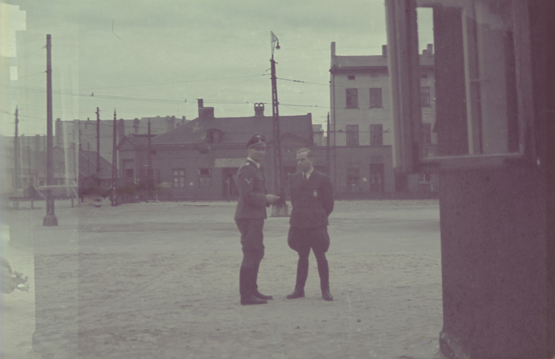 A German official [probably Biebow] talks to an SS officer in the Lodz ghetto.