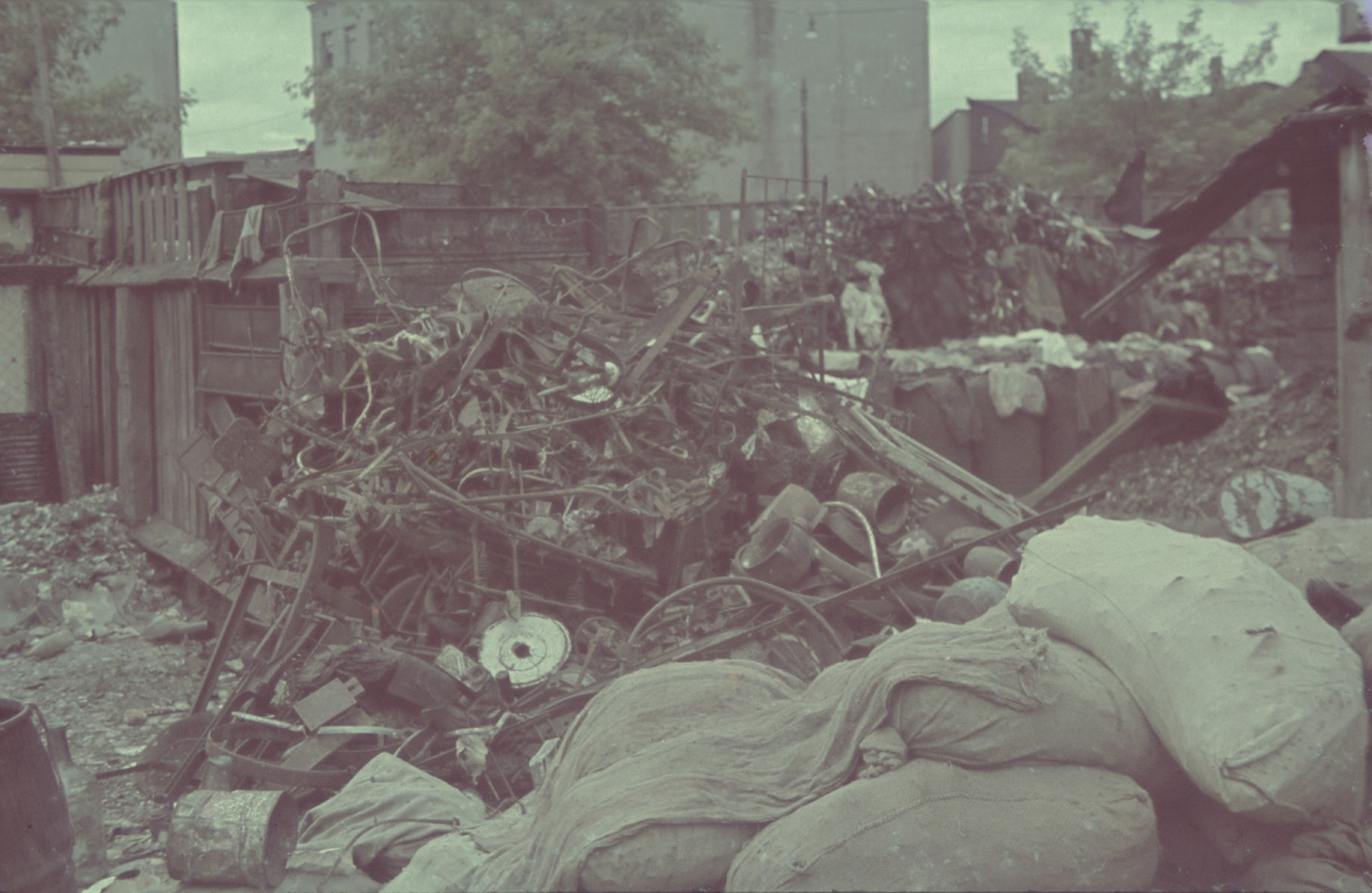 "Large pile of debris in the Lodz ghetto.  Original German caption: ""Litzmannstadt-getto, Altmaterial Lager"" (old material warehouse), #23."
