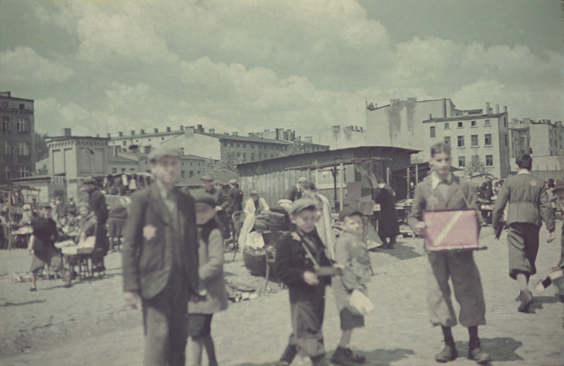 Residents bring their goods to an open-air market in the Lodz ghetto.