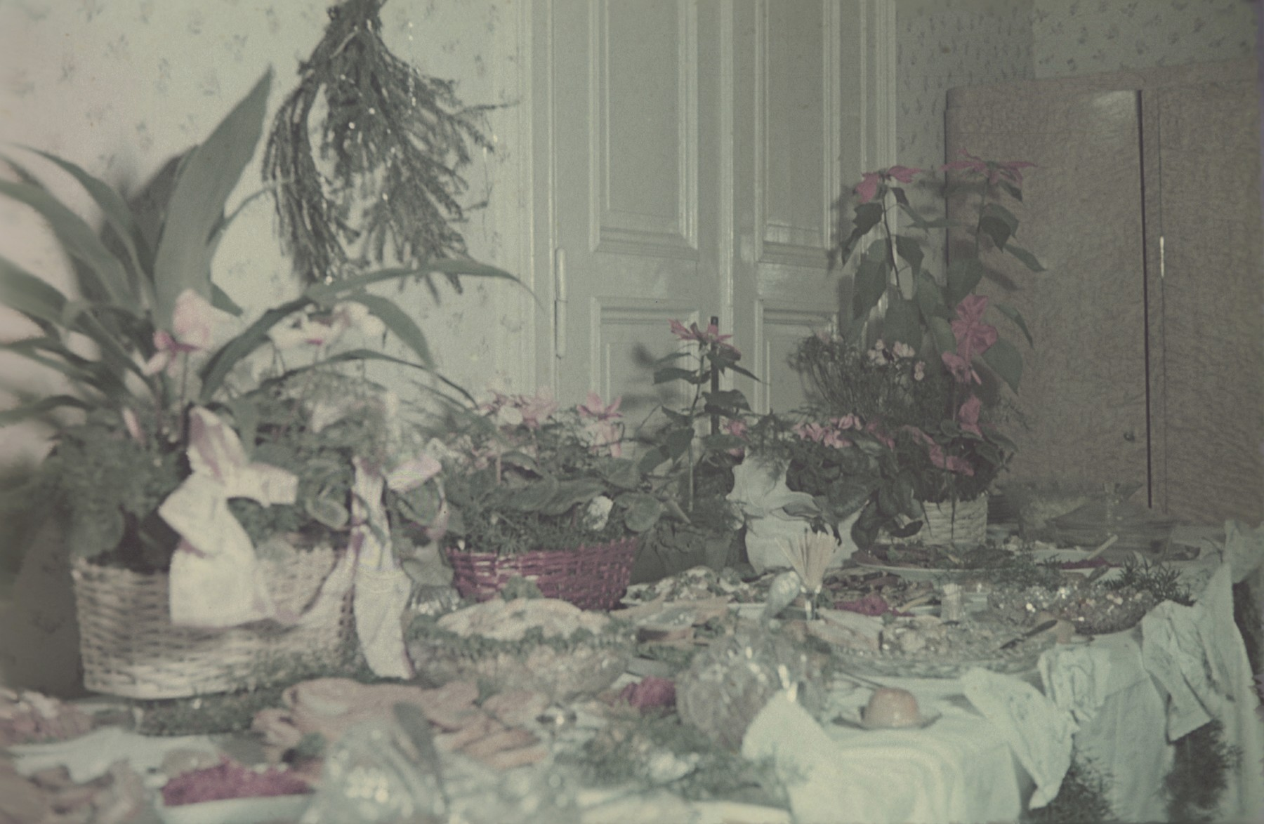 A table decorated with plants and food for a celebration of the birthday of Hans Biebow, the German head of the Lodz ghetto administration.