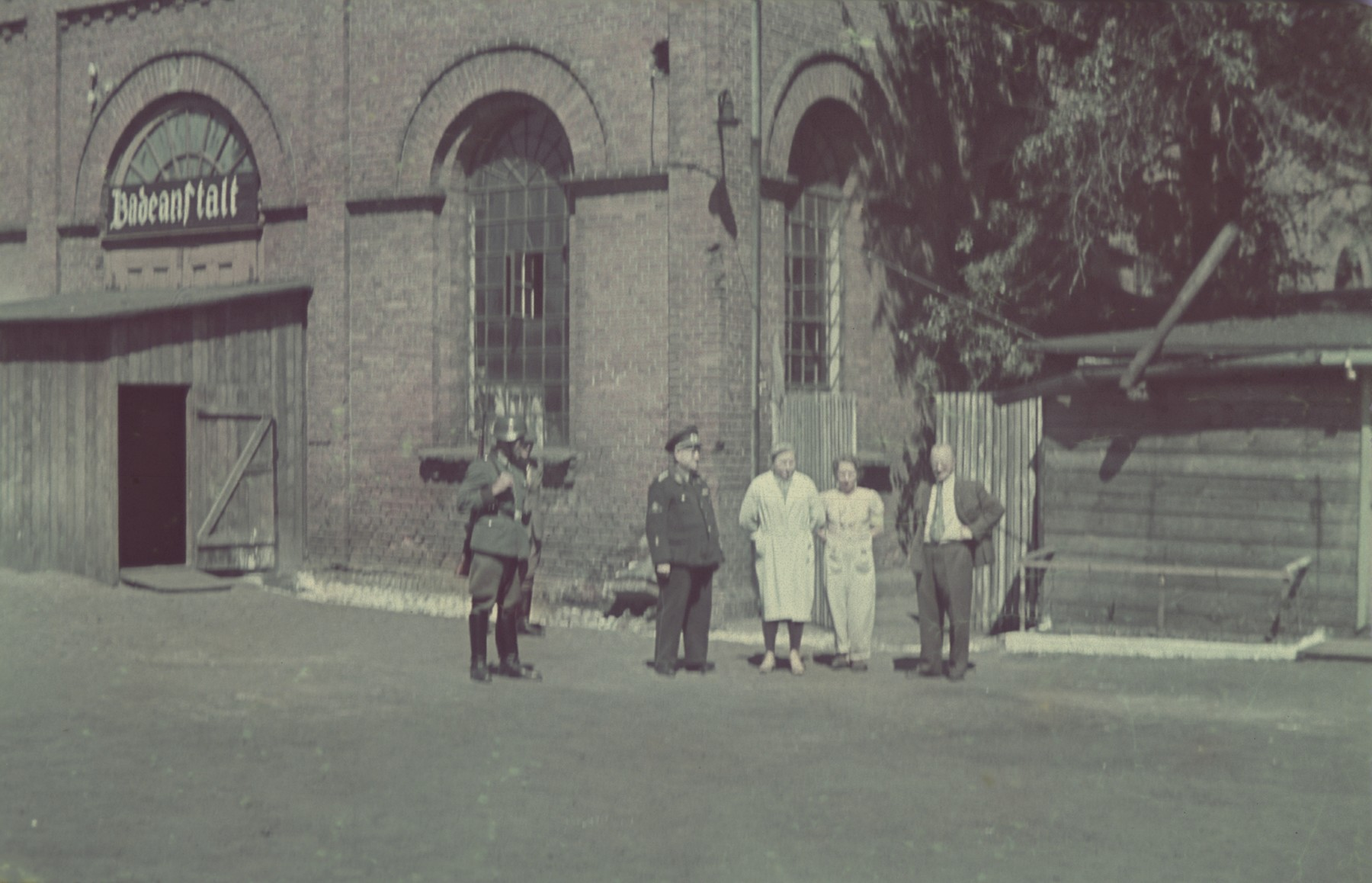 "German officials stand outside the delousing baths in Pabiance.  Original German caption: ""Pabianice: Entlausungstelle (delousing), #38."