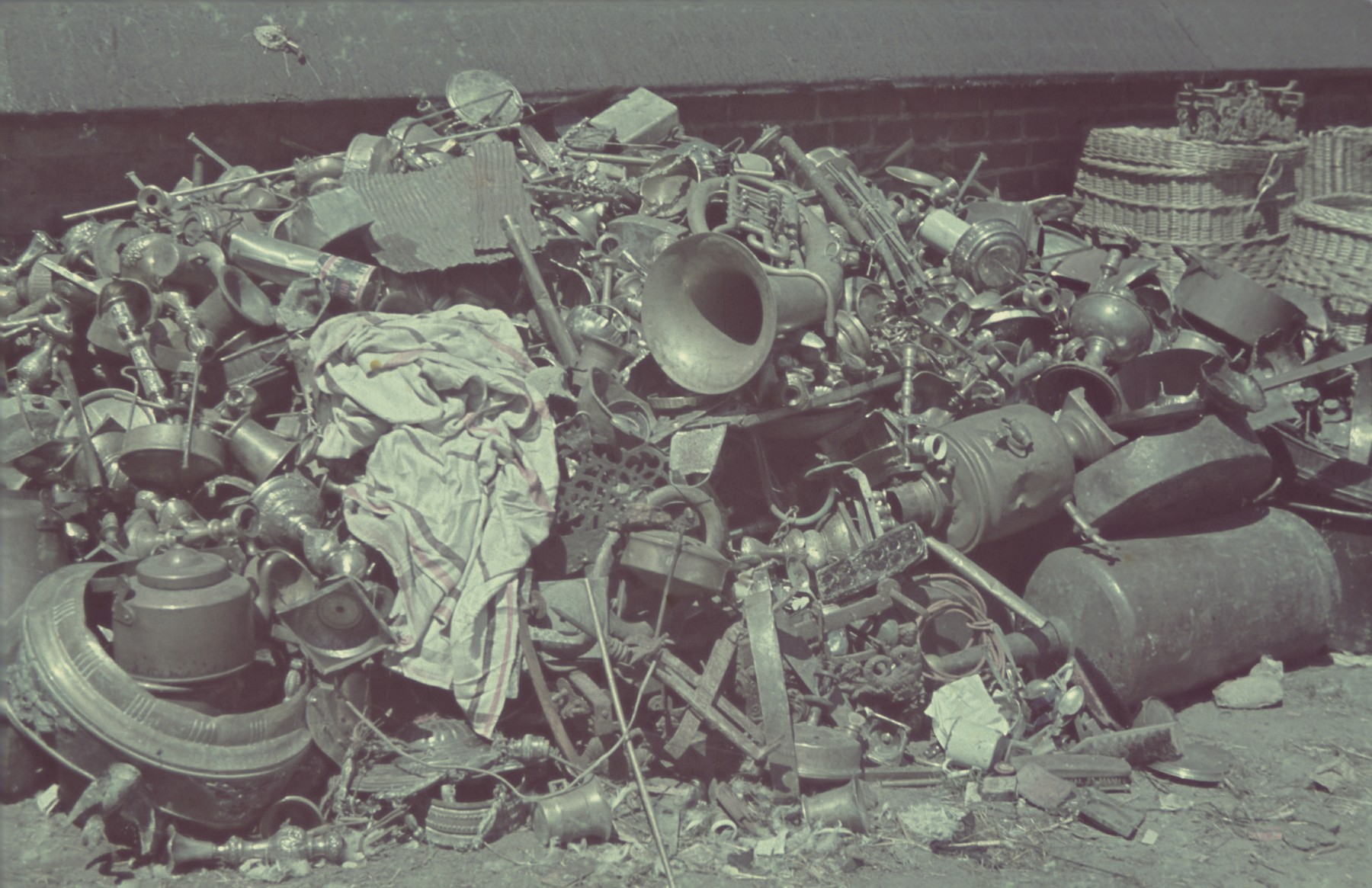 "Pile of discarded personal items and scrap metal in the Pabianice labor camp/storage facility.  Original German caption: ""Pabianice, Judenlager"" (Jewish camp), #30."
