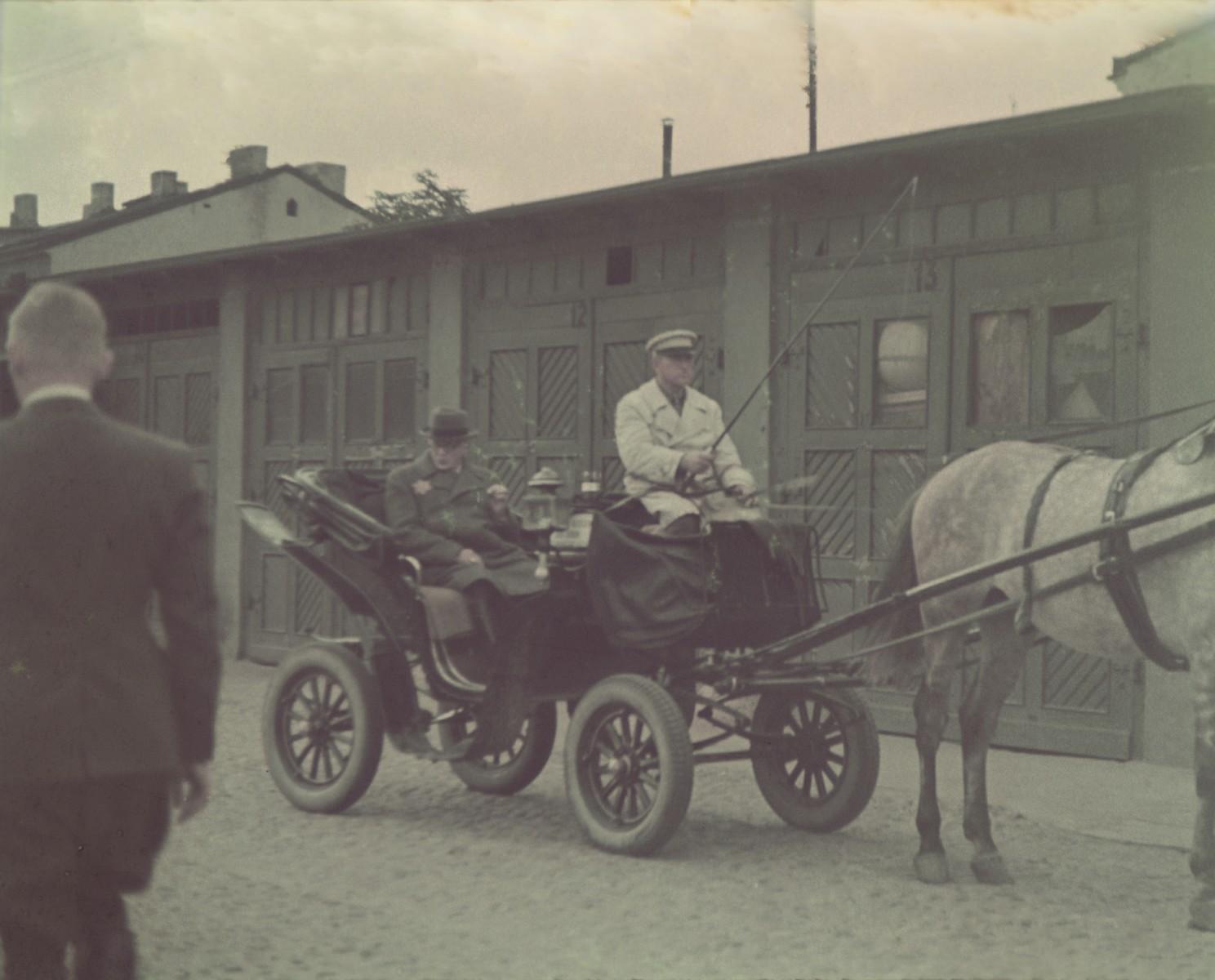 """Mordechai Rumkowski rides through the Lodz ghetto in a horse-drawn carriage.  Original German caption: """"Judenaeltester"""" (Jewish elder)."""
