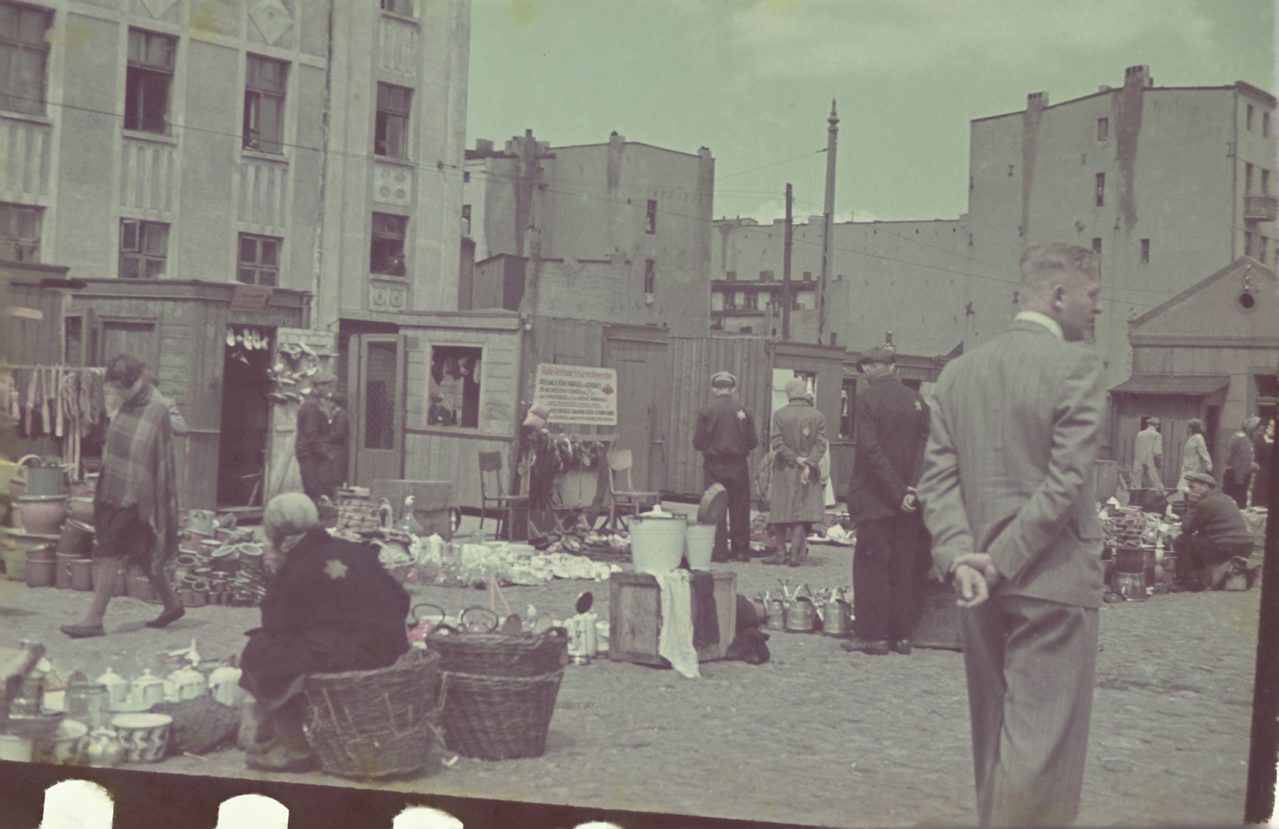A market in the Lodz ghetto.    Hans Biebow is pictured.