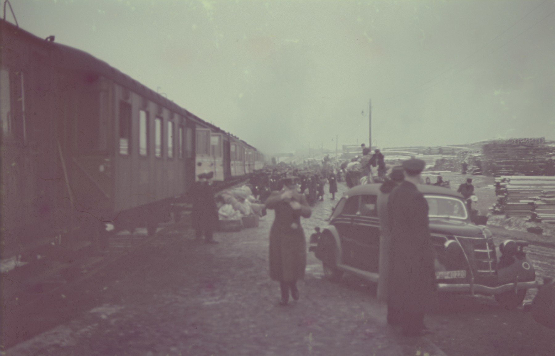"View at the railroad siding in the Lodz ghetto where Jews prepare to board a passenger train during a deportation action from the ghetto.  Original German caption: ""Judenaussiedlung"" (Jewish resettlement), #117."