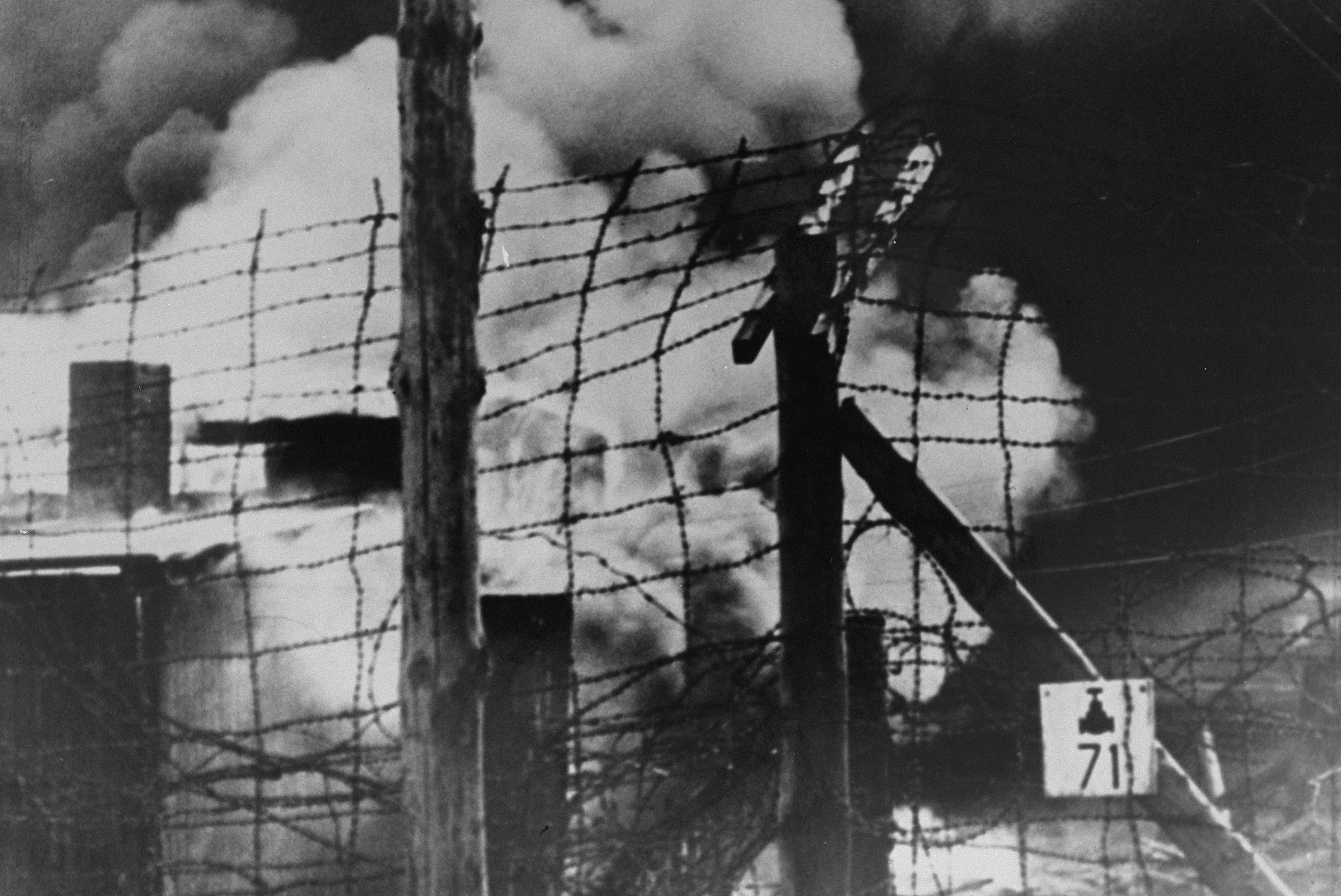 View of the burning barracks in camp no. 1 in Bergen-Belsen to prevent the spread of typhus.