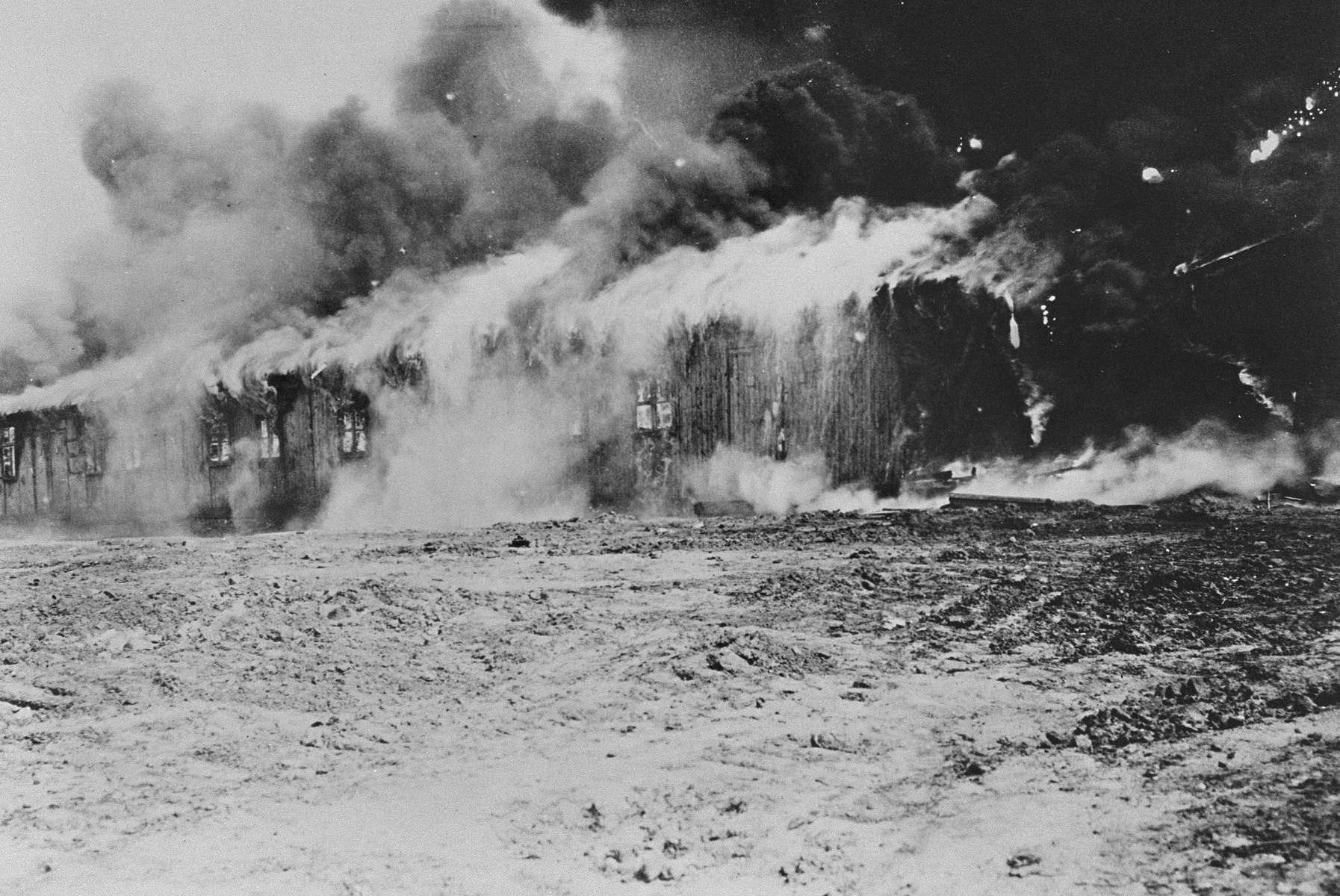A barrack in camp no. 1 of Bergen-Belsen goes up in flames after the British Army sets it on fire  in an effort to stop a typhus epidemic.