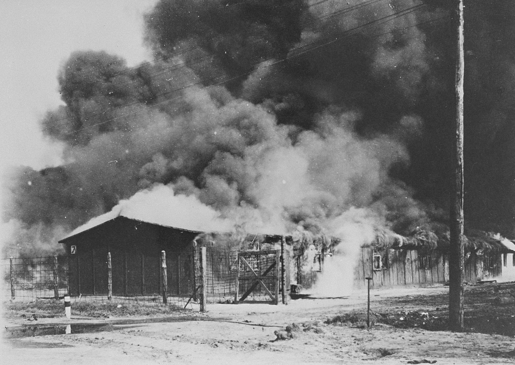 Burning the typhus-infected barracks of camp no. 1 in Bergen-Belsen.