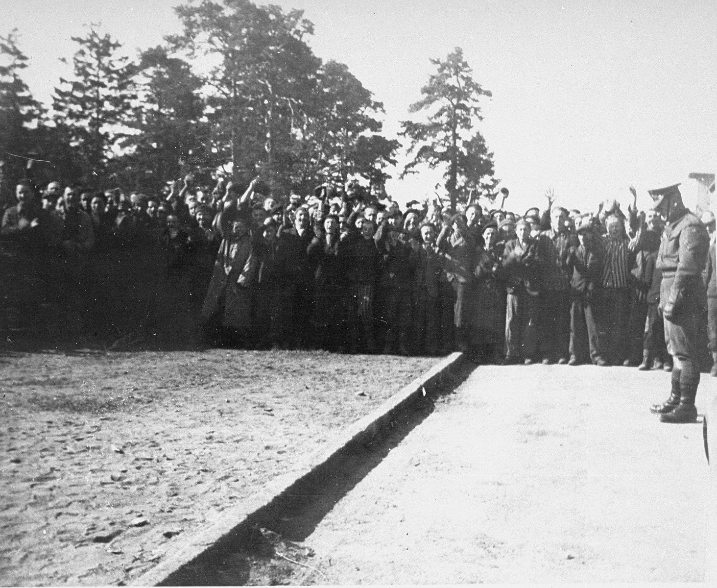Survivors pay homage to people killed in  Bergen-Belsen concentration camp during a memorial service.