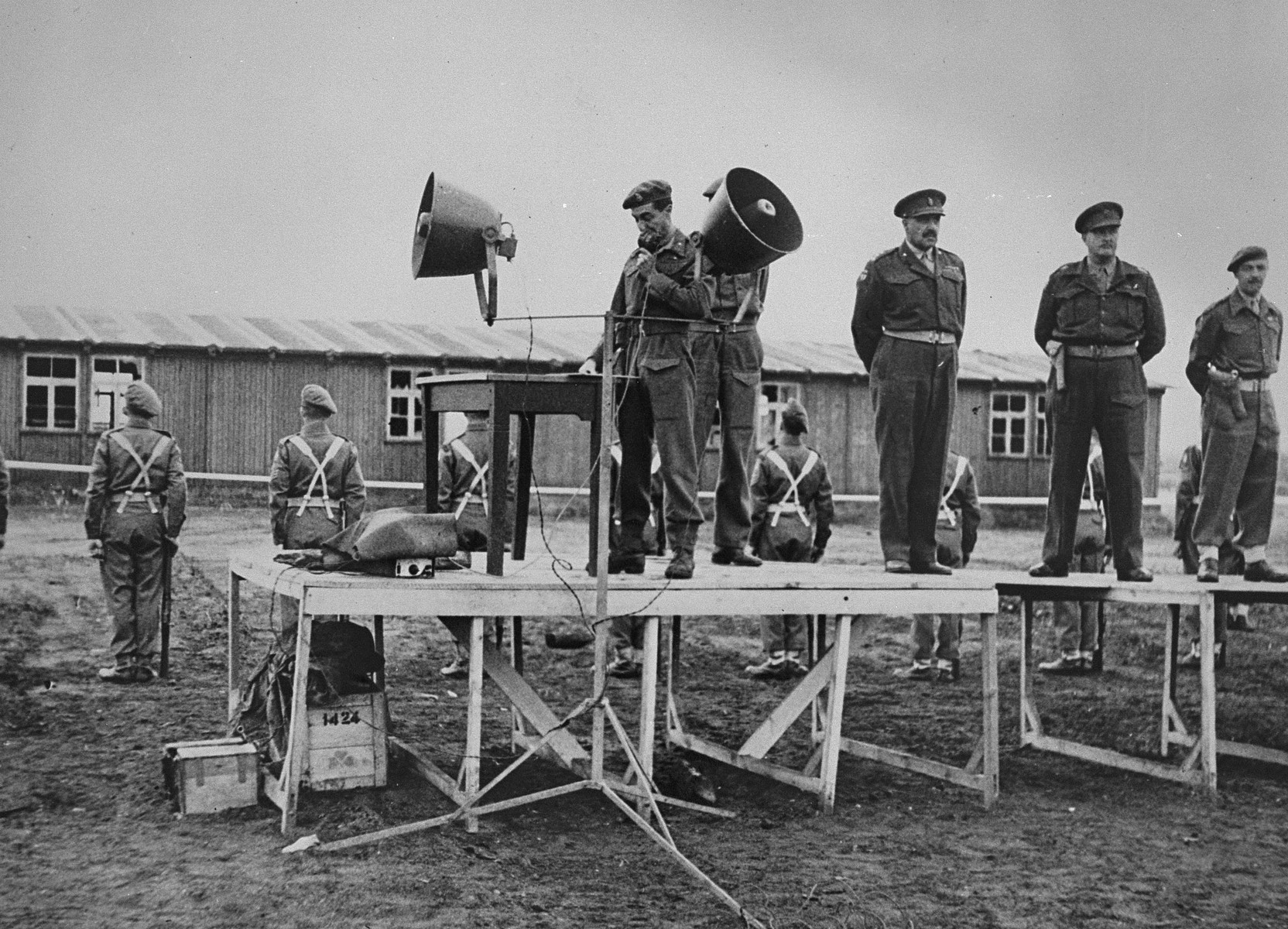 Brigader General Glyn Hughes gives the order to set fire to the barracks in camp no. 1 of the former Belsen concentration camp.    Belsen had to be burned down to prevent the spread of typhus.  At extreme right is Col. Johnson of Medical Corps, 32 CCS.