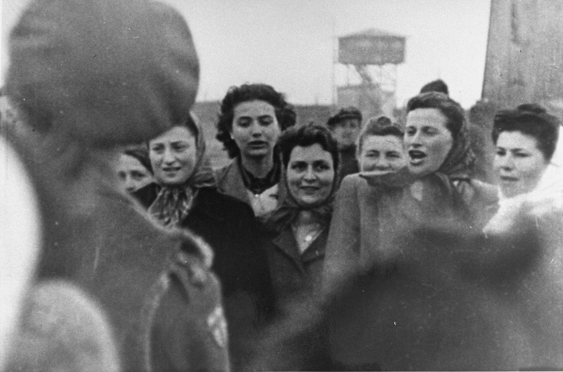 Survivors in Bergen-Belsen greet a British soldier.