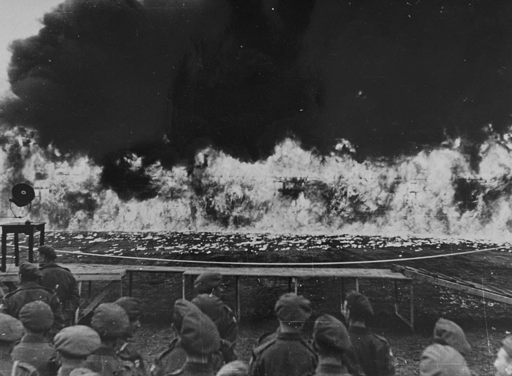 British troops watch the destruction of camp no. 1 in Bergen-Belsen.