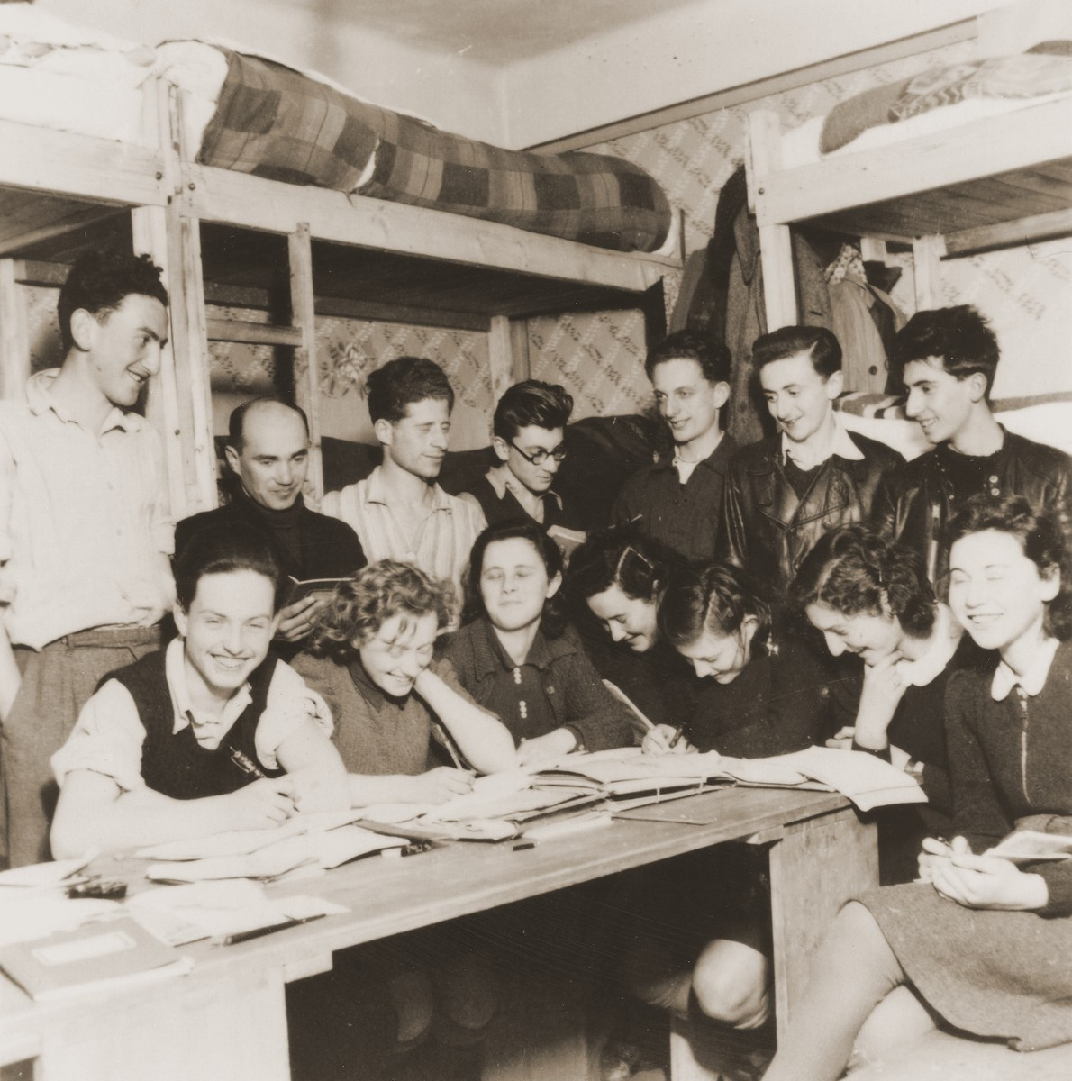 Members of the Hashomer Hatzair from the Kladovo transport are gathered in a room in the Sabac refugee camp.  Erich Nachhaeuser is pictured standing third from the left.