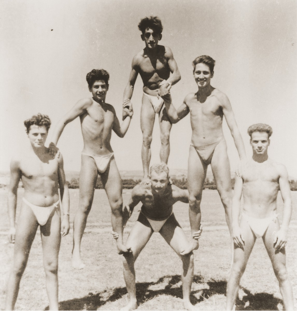 Members of the Hashomer Hatzair Zionist youth movement, who were part of the Kladovo transport, build a human pyramid on the banks of the Danube.