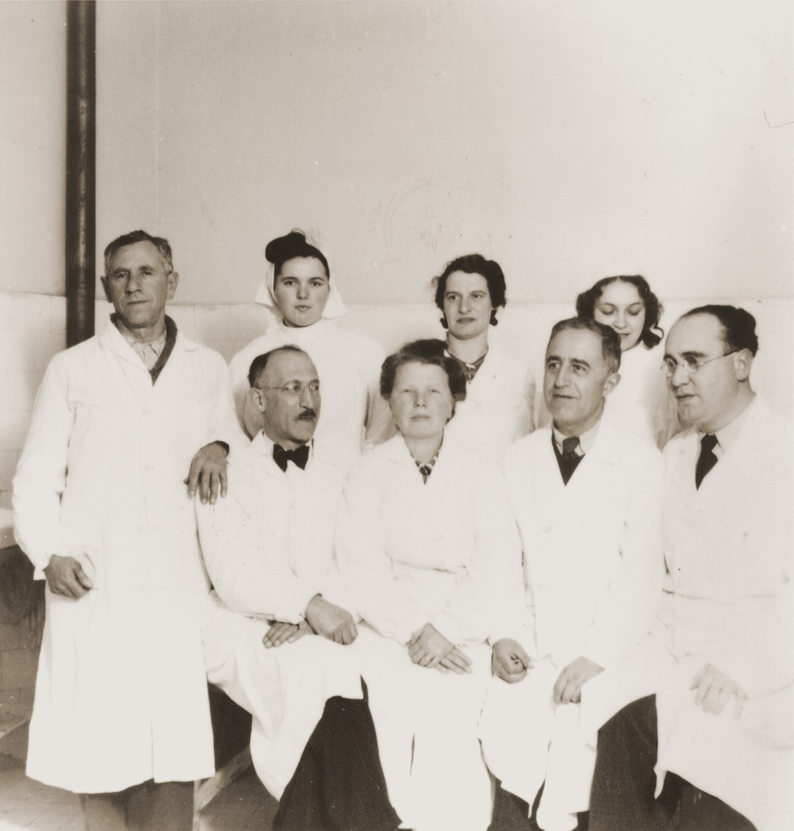Group portrait of physicians who provided medical care for members of the Kladovo transport at an infirmary in Sabac.