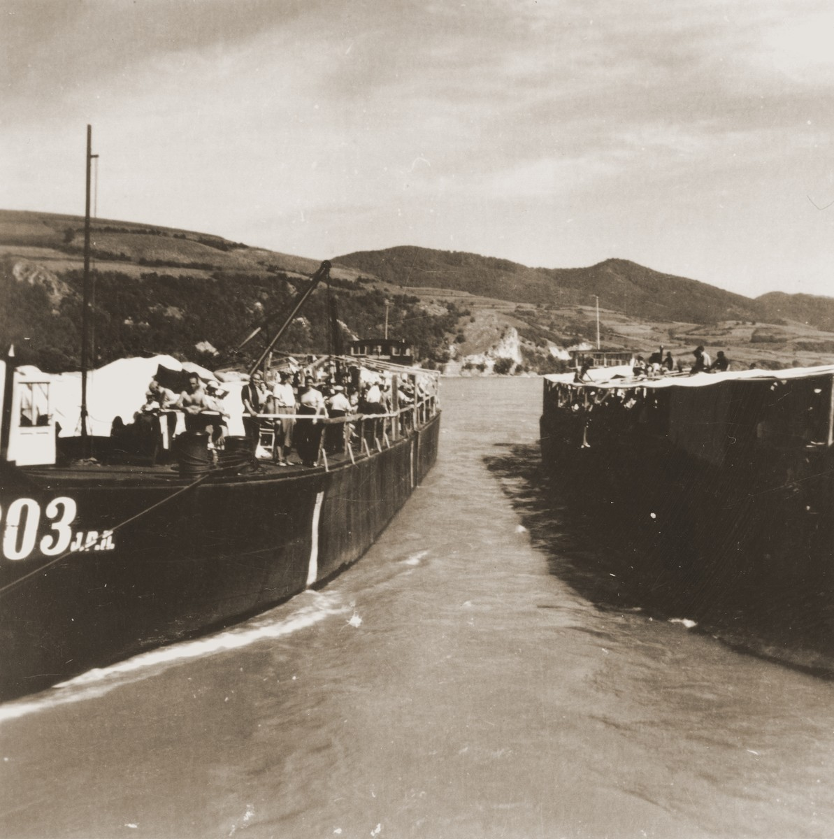 Jewish refugees from the Kladovo Transport are seen onboard two of the three vessels that are transporting them to Sabac.