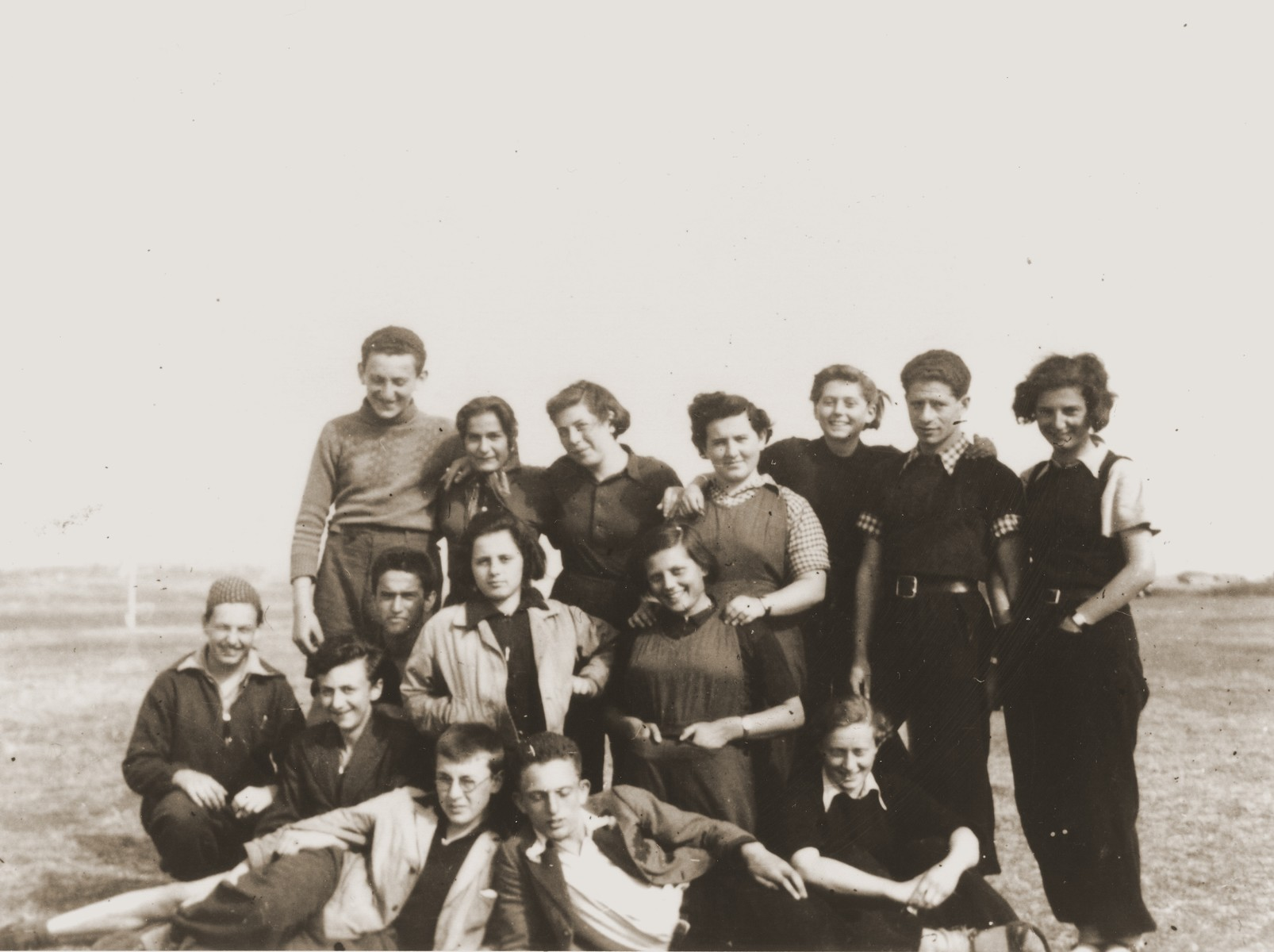 Group portrait of members of the Hashomer Hatzair Zionist youth group from the Kladovo transport.  Erich Nachhaeuser, the group's leader, is pictured standing second from the right.