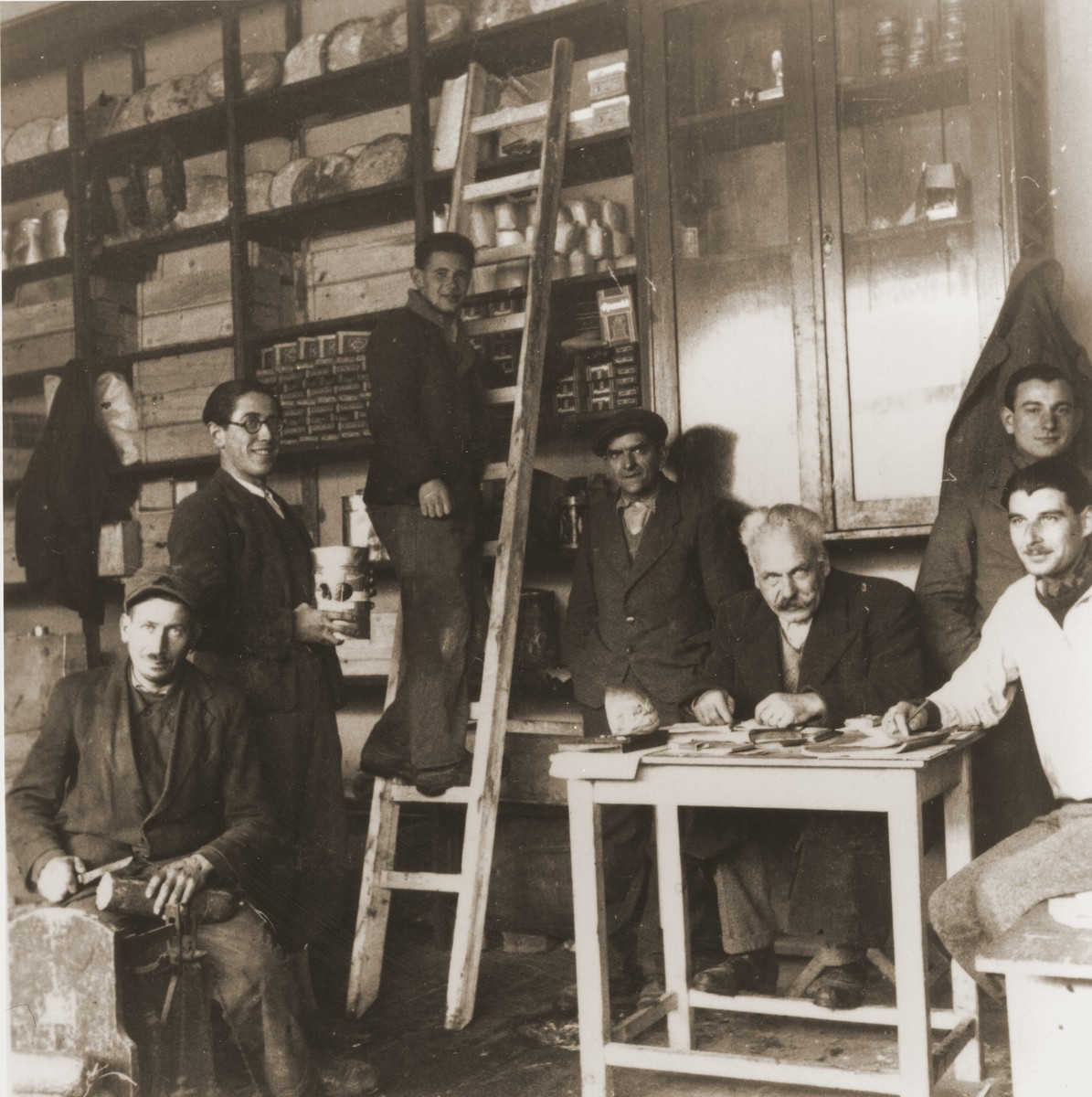 Jewish refugees from the Kladovo transport in a food storeroom at the Sabac refugee camp.