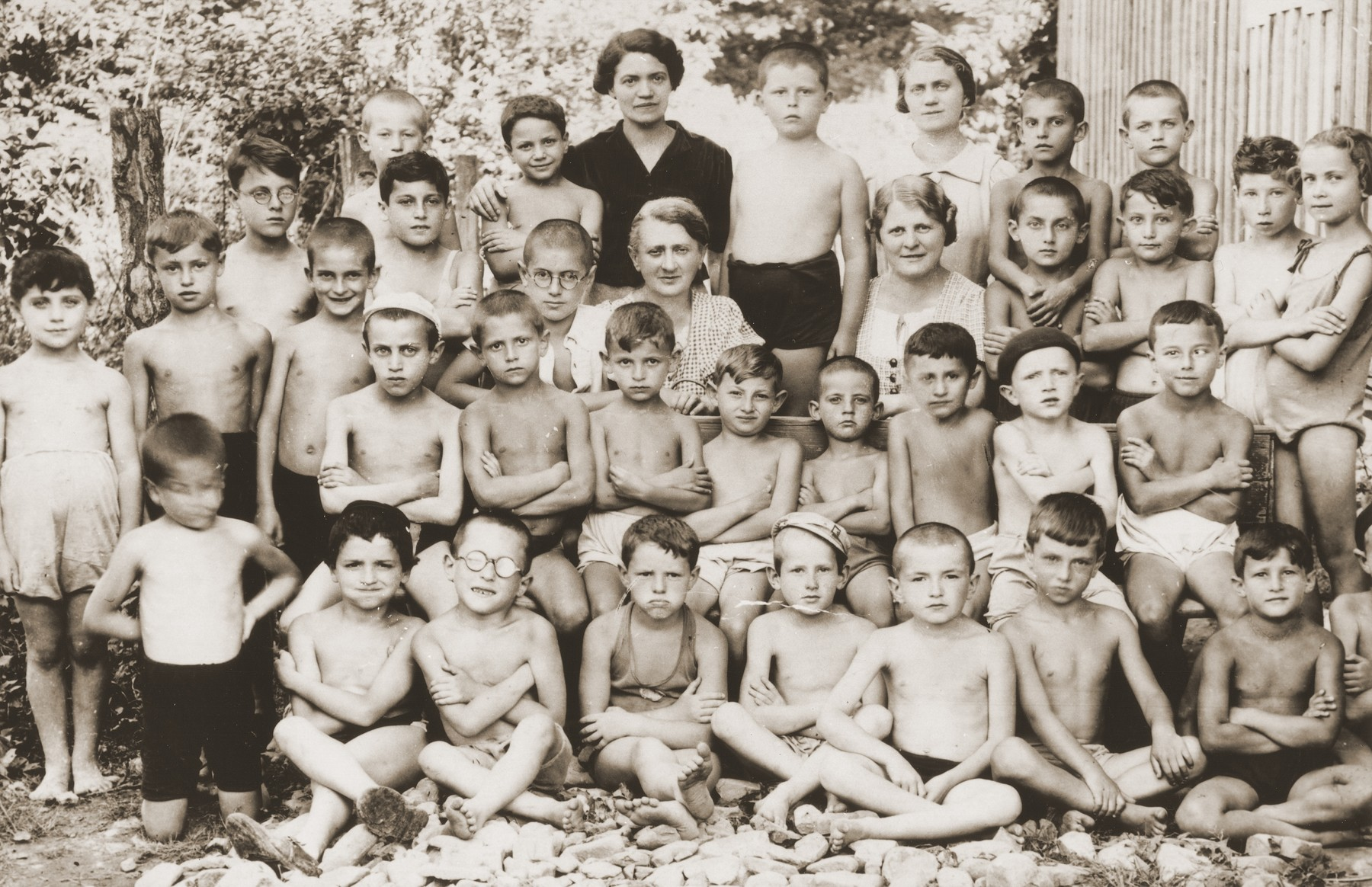Group portrait of Jewish children at an OSE summer camp.     Among those pictured are Anny (Hubner) Andermann (third row, fifth from the right); OSE pediatrician, Dr. Salter (next to Anny); and her son, Frederick Andermann (standing between the two women).