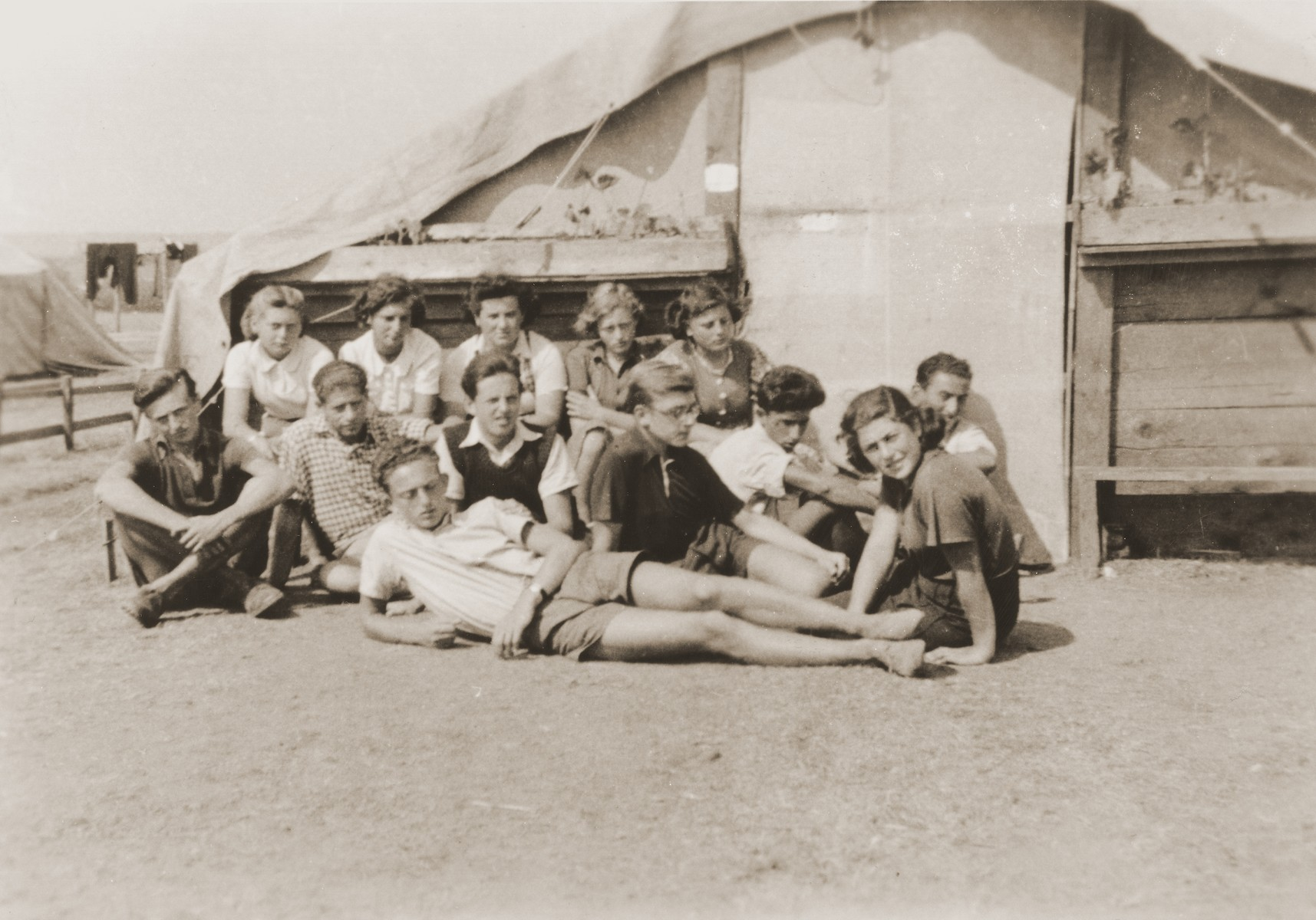 Members of the Hashomer Hatzair in front of their tent in a refugee camp for members of the Kladovo transport.    Erich Nachhaeuser is pictured in the middle, second from the left.  Ruth Weisz is in the back row on the far right and Seppl Baumgartner is seated in front of her.