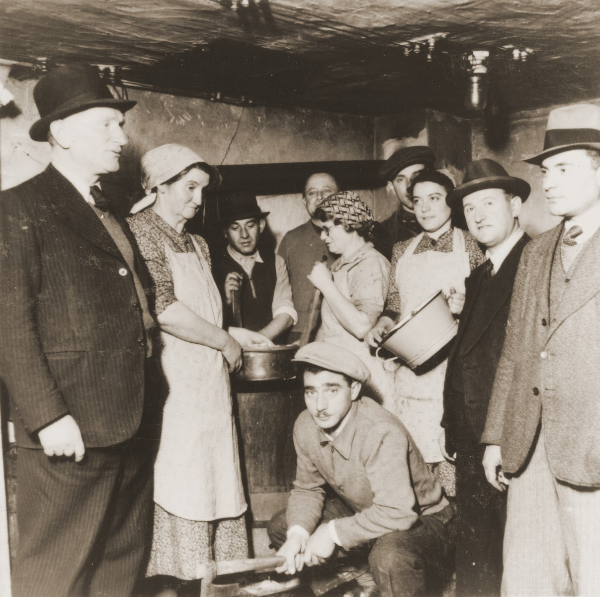 Jewish refugees from the Kladovo transport in a makeshift kitchen on board one of the vessels in Kladovo harbor.