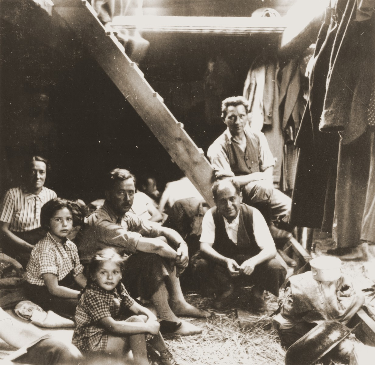 Jewish refugees from the Kladovo transport sit below deck during their journey from Kladovo to Sabac.