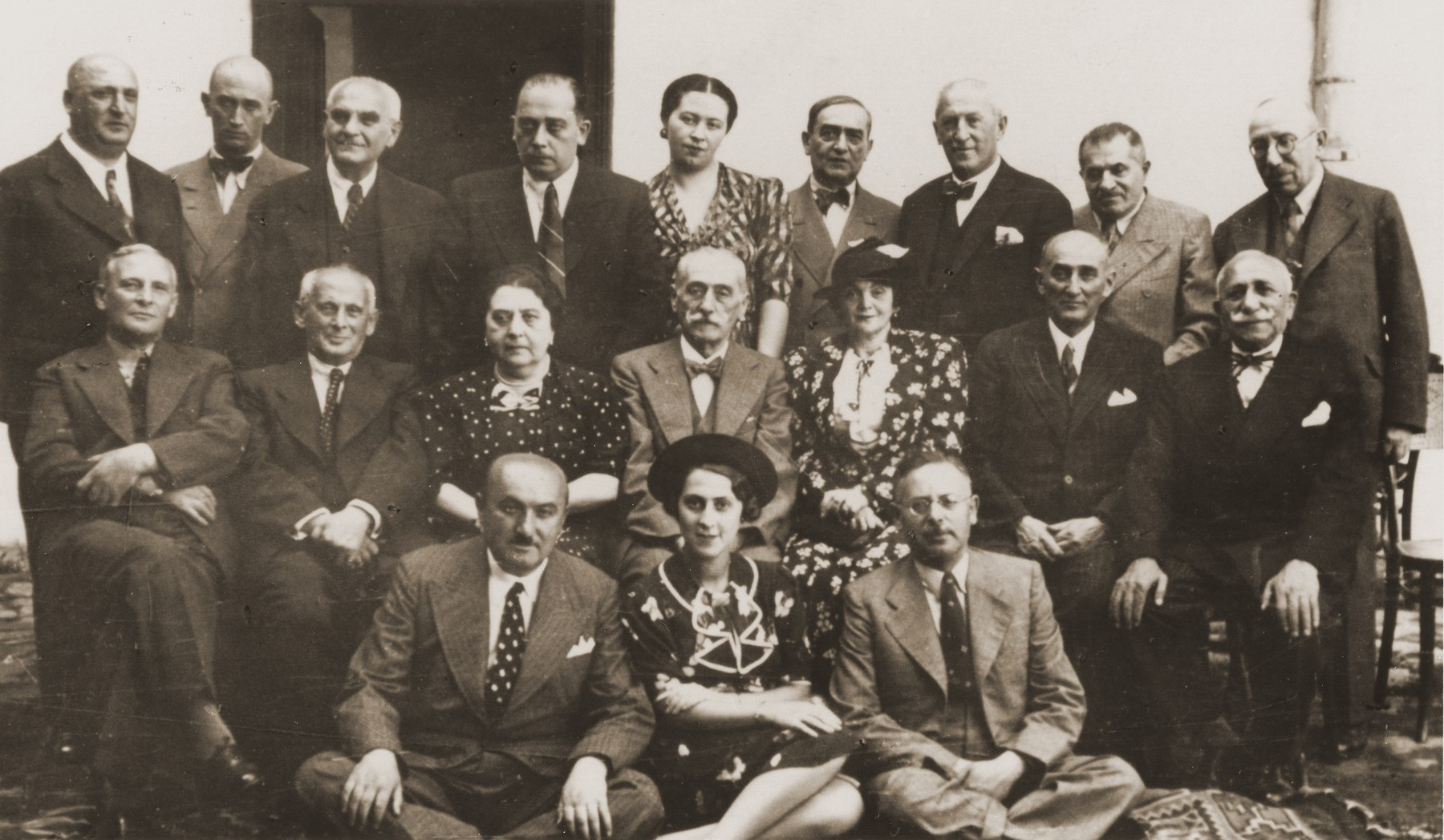 Members of the mostly Jewish Masonic lodge in Czernowitz celebrate the 70th birthday of Dr. Isidor Gold (center).  Max Gottfried is pictured in the top row at the right.  Women attended lodge meetings only on special occasions such as this one.