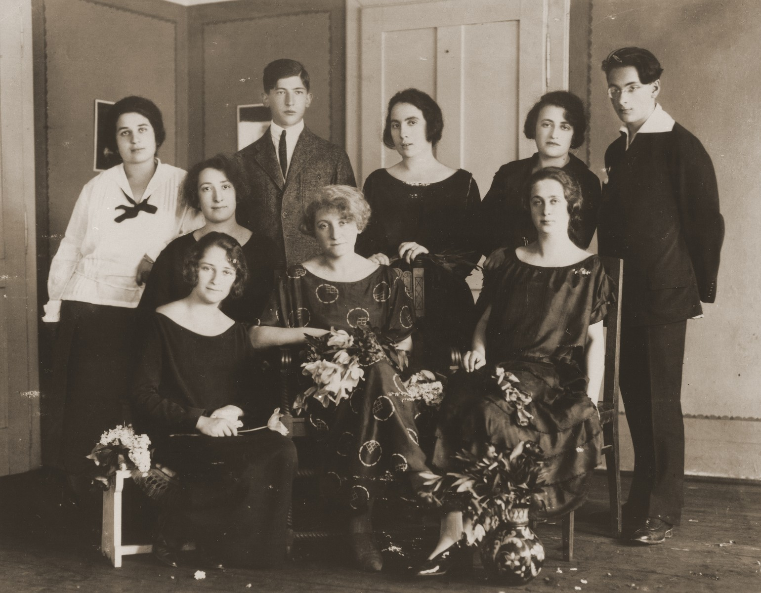Mrs. Kolnik, a piano teacher in Czernowitz, poses with her students at a piano recital.  Among those pictured are:  Hansi Lifschitz Geiger (top, left) and Stella Schmirer Loebl (bottom, left).