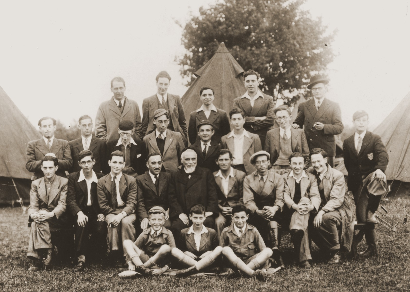 "Group portrait of members of the Ezra youth movement in a ""harvesting camp"" outside of London, where they assisted local farmers.    Most of the boys are German Jews who came to England on the Kindertransport.    ."