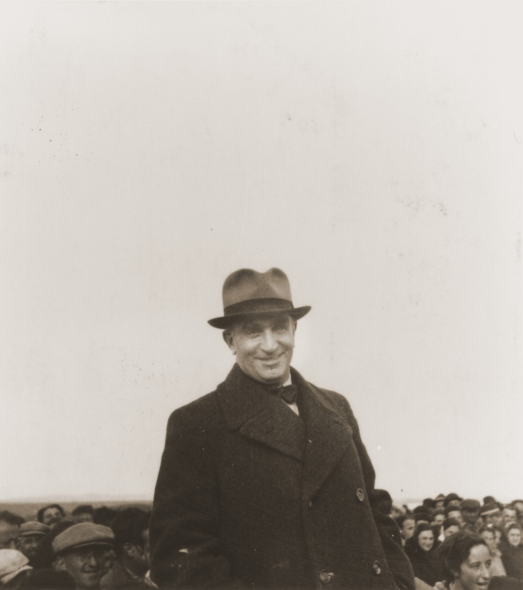 Sime Spitzer, General Secretary of the Federation of Jewish Communities in Yugoslavia, stands among a group of Jewish refugees from the Kladovo transport.