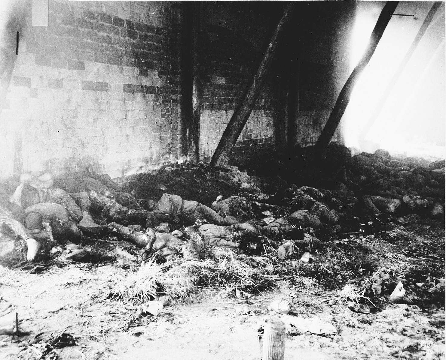 Corpses of prisoners lie near the inside south wall of the barn outside of Gardelegen where over 1,000 prisoners were burned alive.