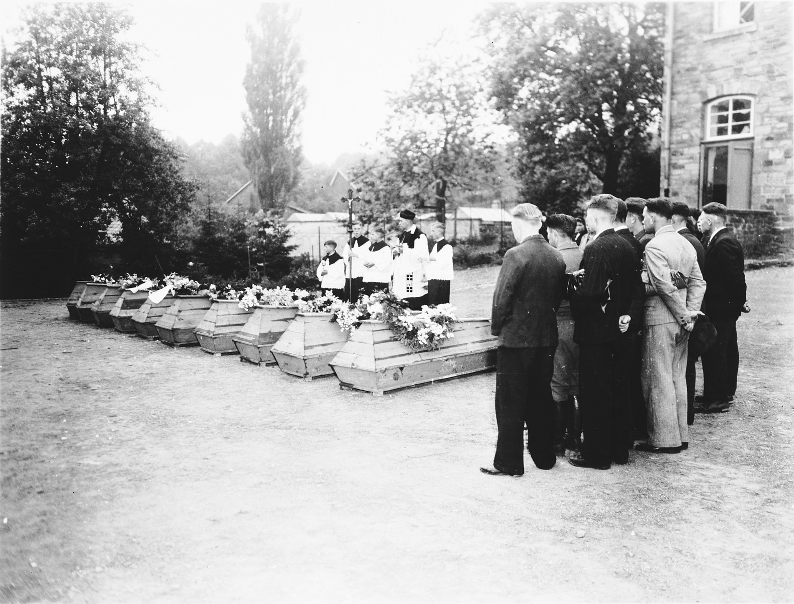 German civilians from Lindlar attend funeral services for the 10 Russians exhumed from a mass grave near the town.    The victims were shot on April 4, 1945, by members of the Volkssturm (civilian militia) in retaliation for the killing of the local group leader (SS, SA?) in Overath.