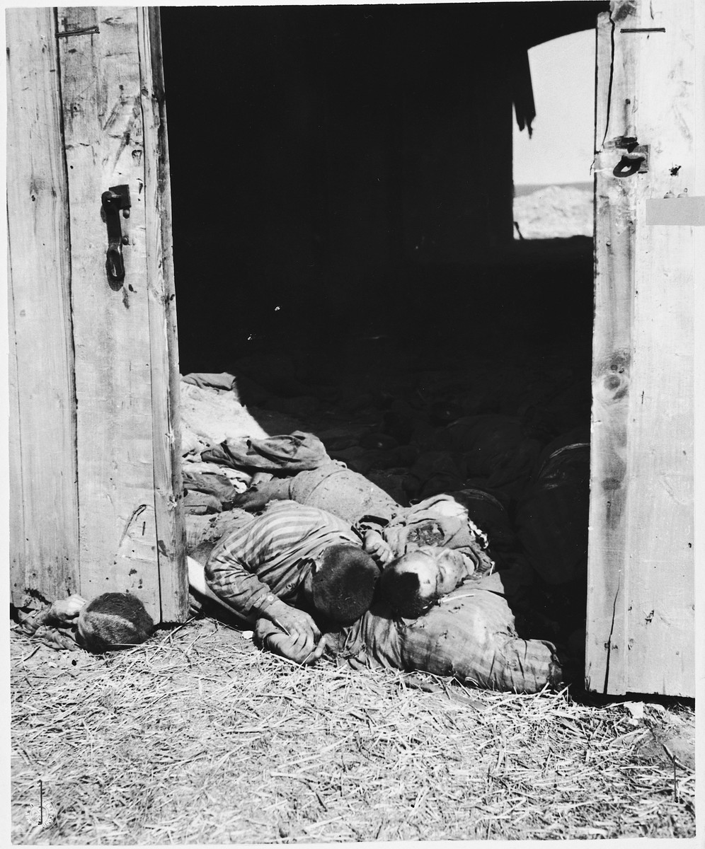 A pile of charred corpses lie near the southeast door of the barn outside of Gardelegen where over 1,000 prisoners were burned alive.