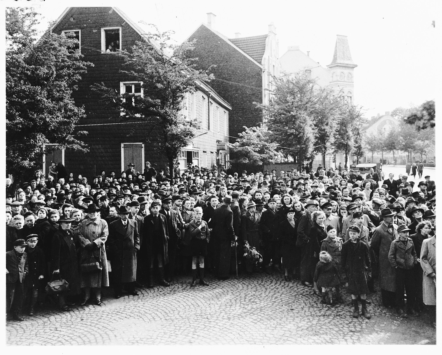 German civilians attend funeral services for the 71 political prisoners, exhumed from a mass grave near Solingen-Ohligs, reburied in front of the city hall.    The victims, most of whom were taken from Luettringhausen prison, were shot and buried by the Gestapo following orders to eliminate all Reich enemies just before the end of the war.