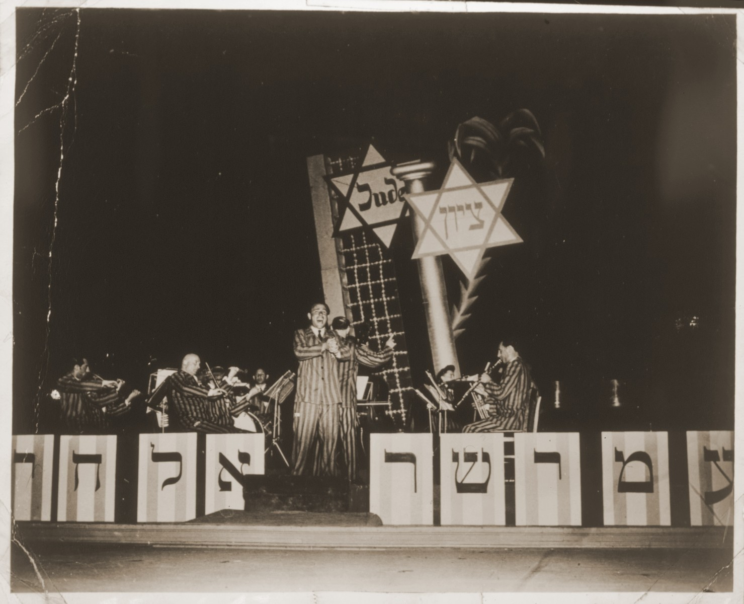 Members of the Jewish Ex-Concentration Camp orchestra perform on stage in Nuremberg, Germany.   Among the musicians pictured are singer George Richter, violinist Max Beker (left) and pianist Fanny Durmashkin-Beker.  See photograph 48234 for alternate caption.