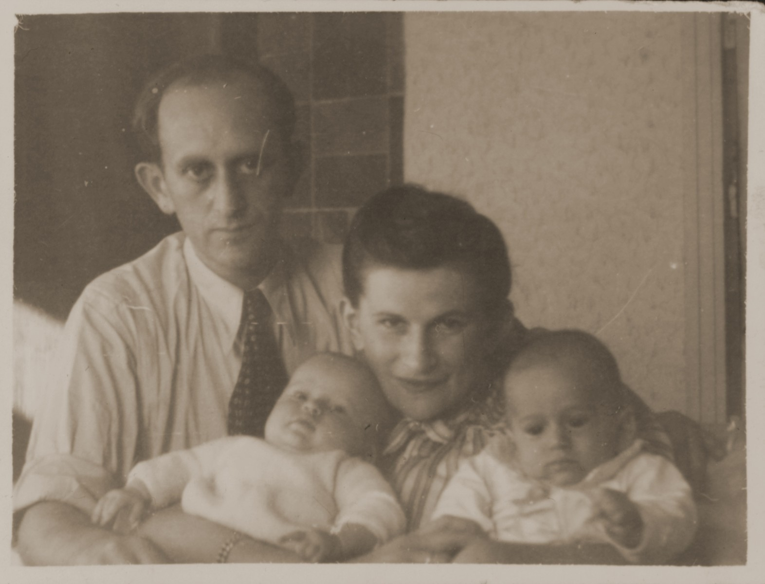 A Jewish DP couple poses with their infant twins.  Pictured are Rachmiel and Eva Zyngier with their children, Yaffa and Yizhak.  Both were from Starachowice and were survivors of the Bergen-Belsen concentration camp.