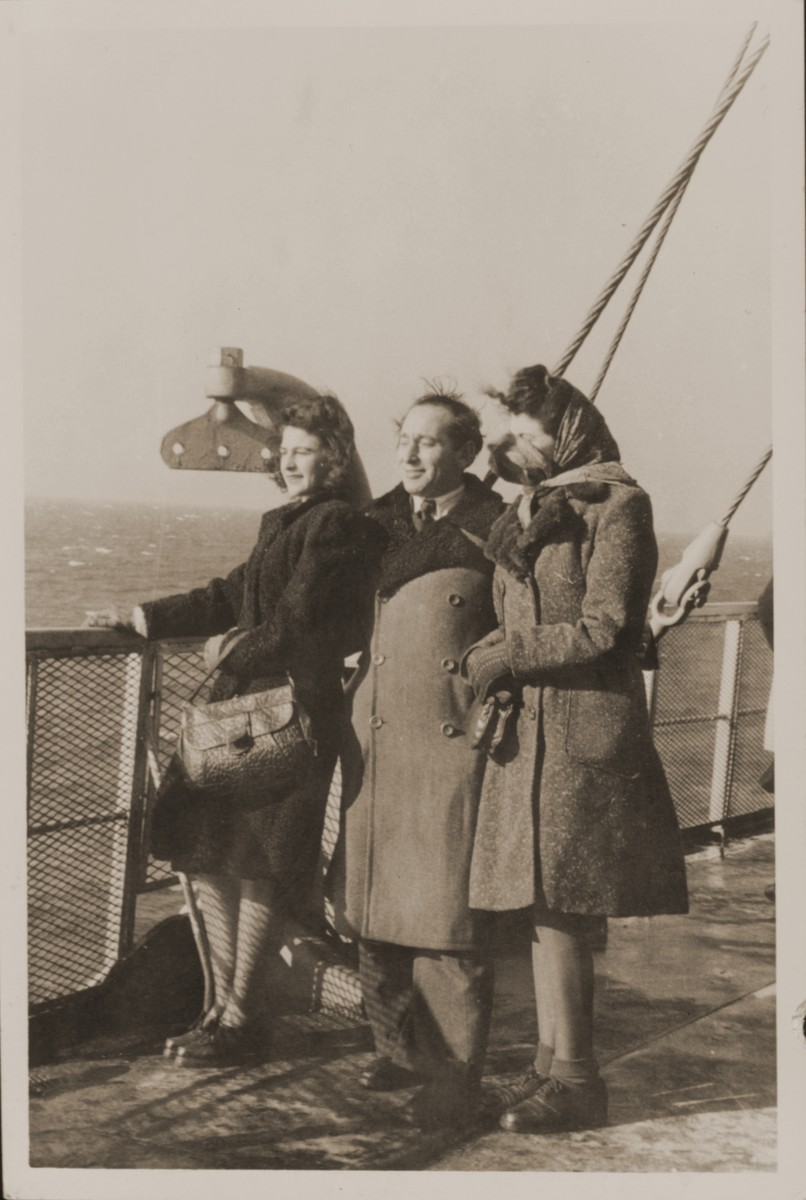 Rozalia (Krysia Laks) and Miles Lerman, and Regina Laks stand on the deck of the Marine Perch while en route to the United States.
