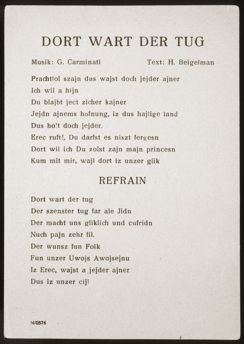 "Song sheet for the Yiddish song ""Dort Wart Der Tug"" (There Awaits the Day) performed by The Happy Boys jazz band, which toured the displaced persons camps throughout Germany from 1945 to 1949.   The music for this song was composed by G. Carminati, the lyrics, by Chaim (Henry) Baigelman."