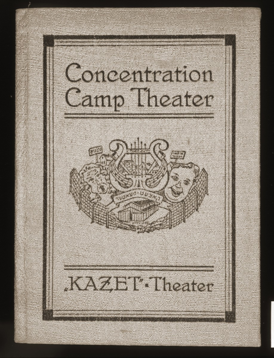 """Membership card/booklet for the Jewish Studio Theater """"Concentration Camp Theater"""" of the Central Jewish committee of Bergen-Belsen issued to Norbert Wollheim.    On the inside cover of the membership card/booklet is the stamp of the Concentration Camp Theater featuring an image of a lyre between comedy and tragedy masks surrounded by a barbed wire fence."""