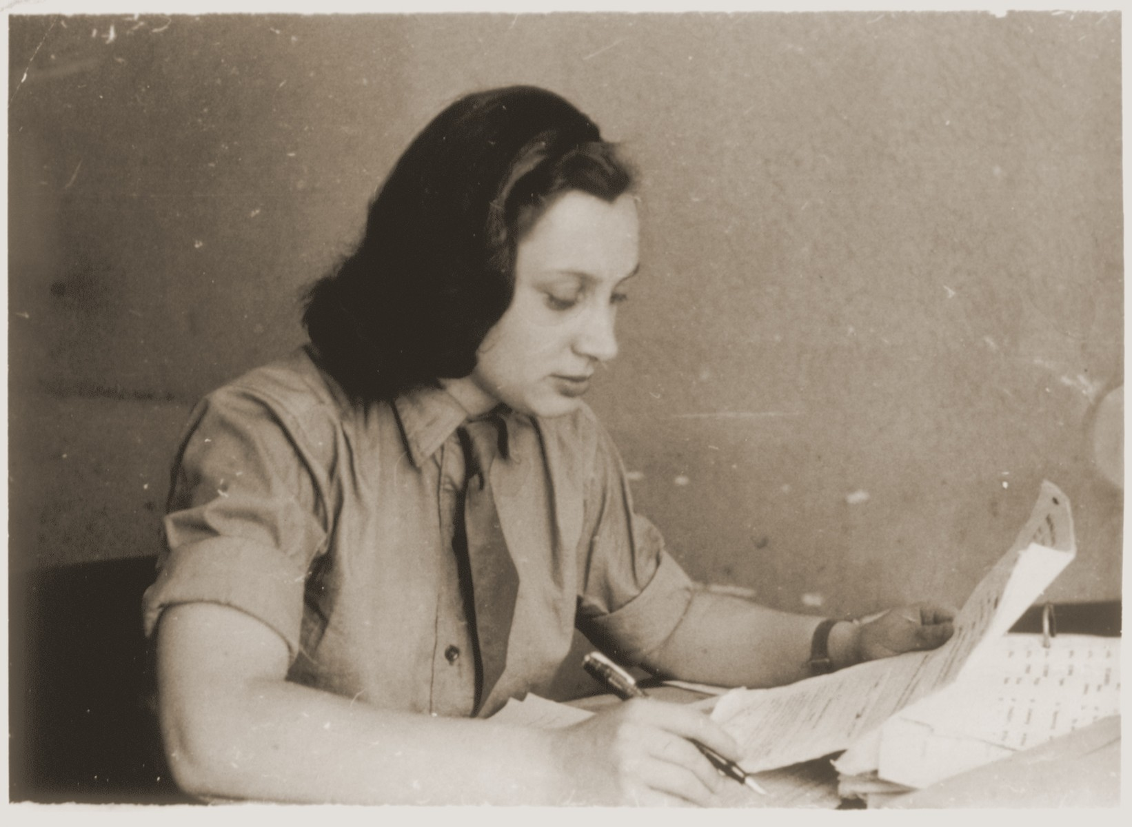 A young Jewish woman works at her desk in Munich, Germany.  Pictured is Anna Gurwitsch.