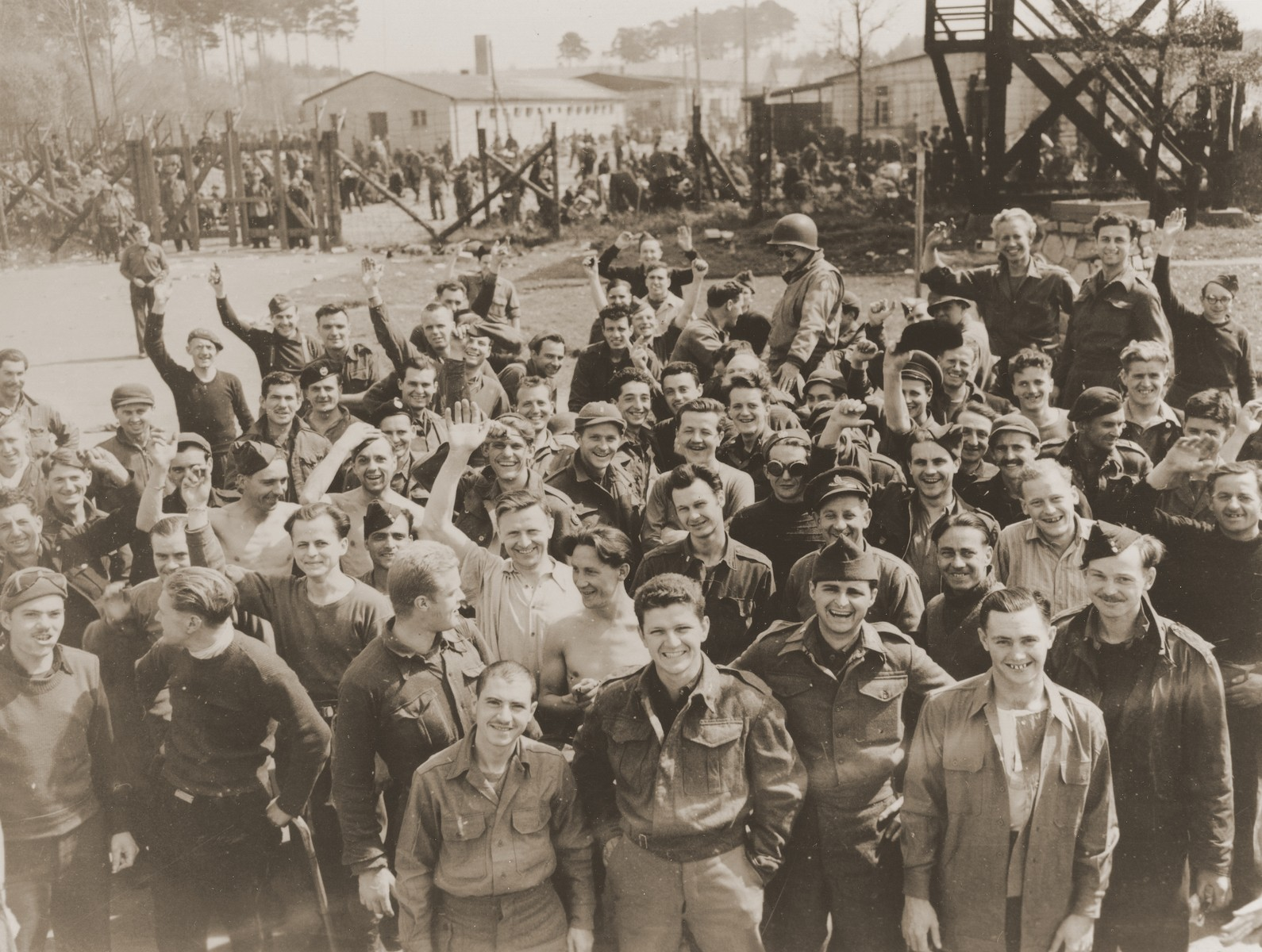 American POWs greet soldiers from the 45th Infantry Division during the liberation of the Fischbach POW camp.