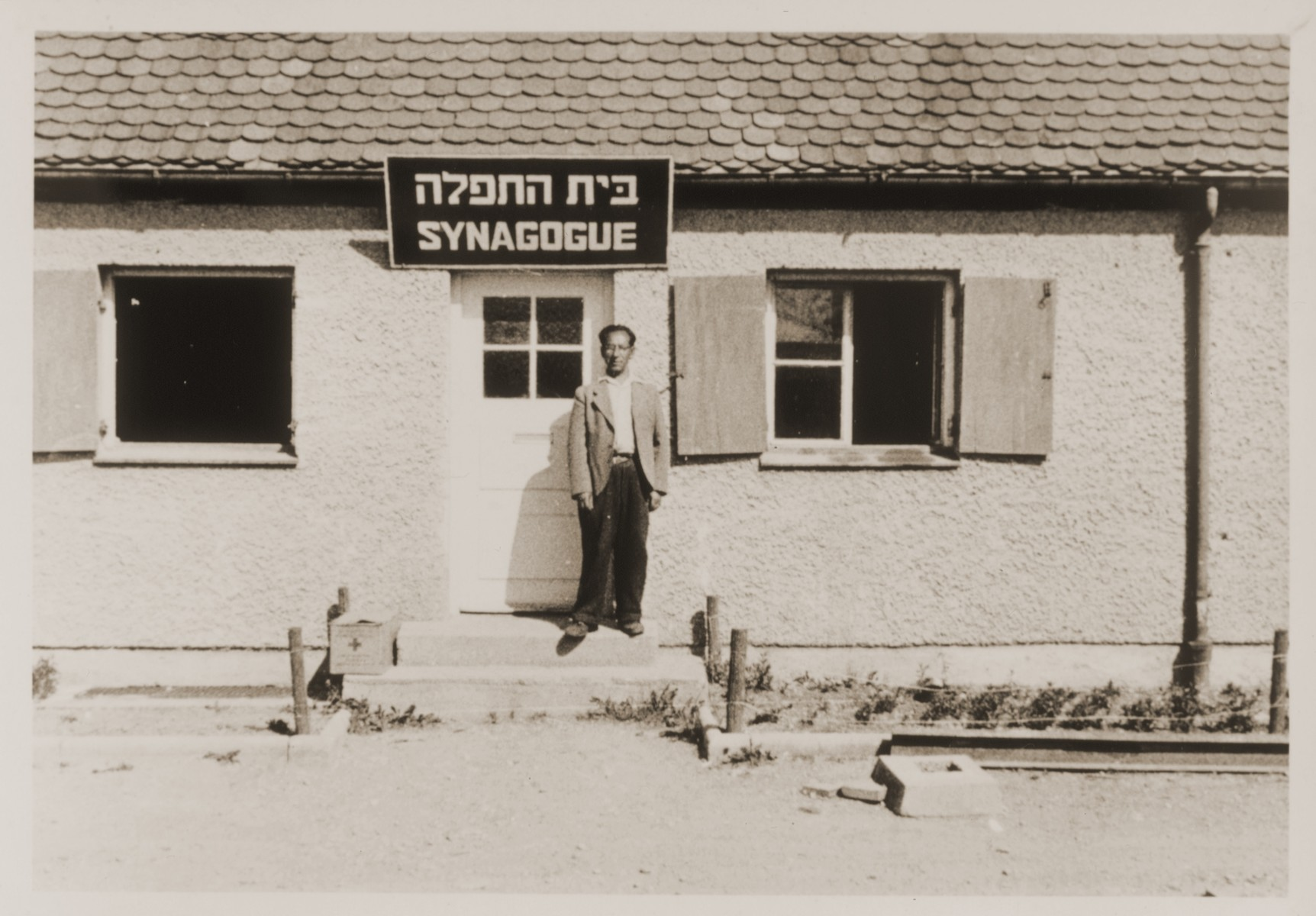 Julius Sutin stands in the doorway of the synagogue at the Neu Freimann displaced persons camp.