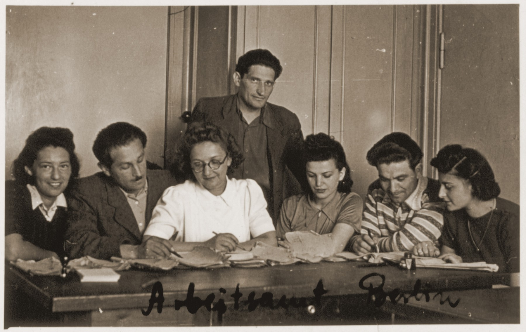 Group portrait of the staff of the employment office at the Schlachtensee displaced persons camp.  Among those pictured are: Rozalia (Krysia Laks) Lerman (far right); Mary Binder (third from the right), and Ms. Langsam (in white).