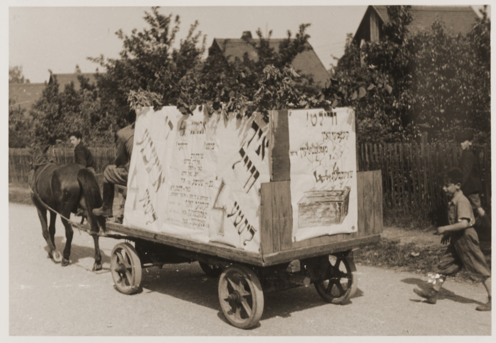 An election campaign wagon at Neu Freimann displaced persons camp covered with posters urging voters to support List #4.