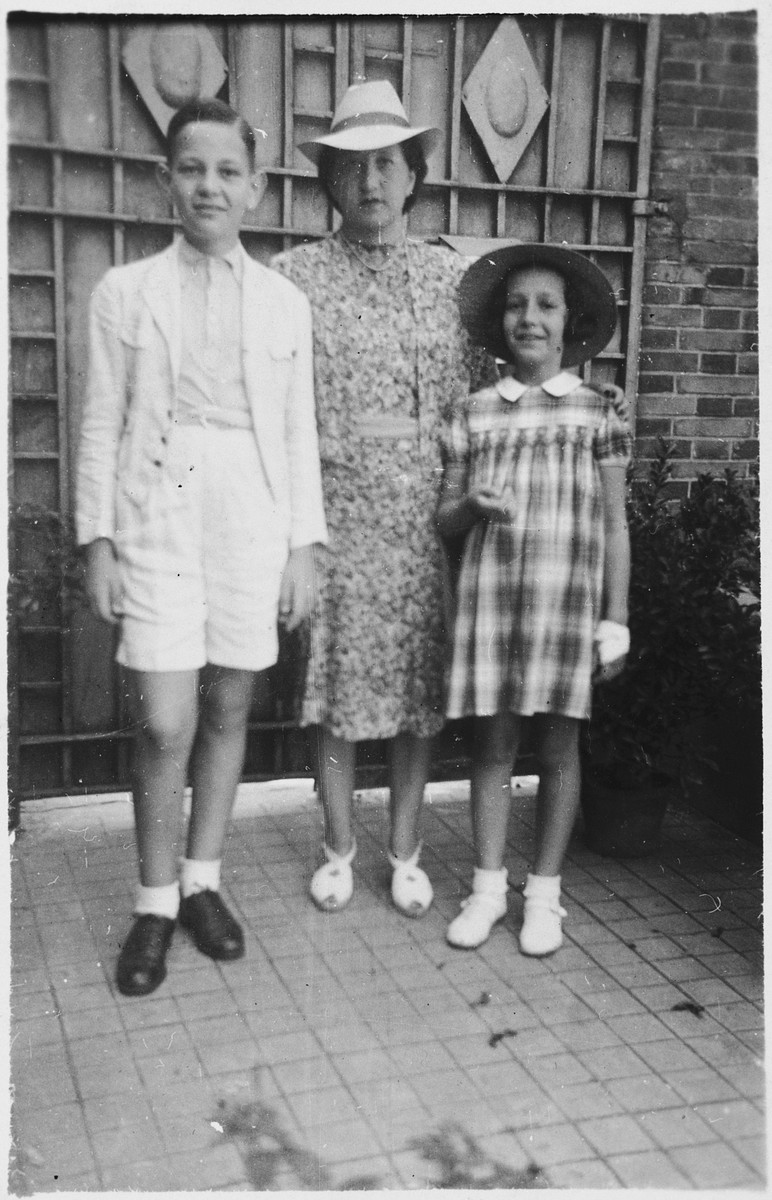 Peter Witting poses outside with his mother and sister.