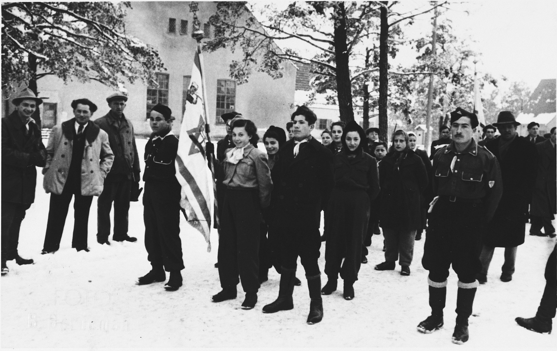 Zionist youth stand at attention with an Israeli flag in the Foehrenwald displaced persons camp.